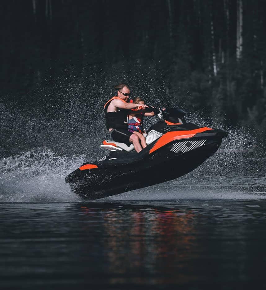 jet ski rider on lake